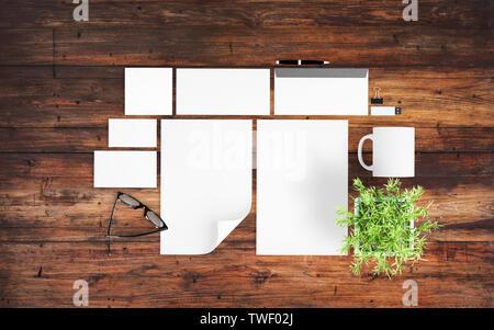 top view of branding elements on light blue desktop mockup 3d rendering - Stock Image