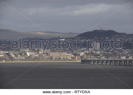 Loganair plane passing Dundee West End Scotland  February 2019 - Stock Image