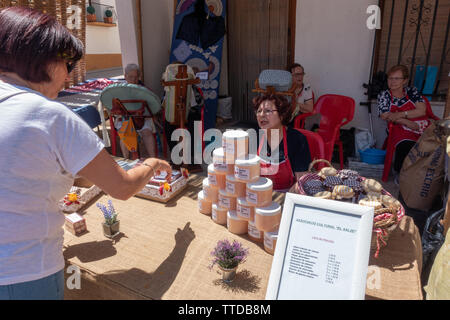 Local market trader selling soap made from cherries at the cherry festival - Stock Image