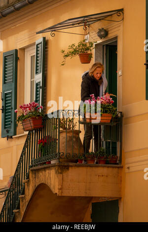 Italy Camogli Liguria a woman is tending to her flower boxes at her apartment - Stock Image