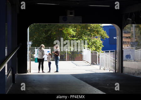 People standing on pedestrian walkway, Stevenage, Hertforshire - Stock Image