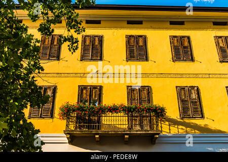 Bright yellow building facade at Levico Terme, Trentino, Italy - Stock Image