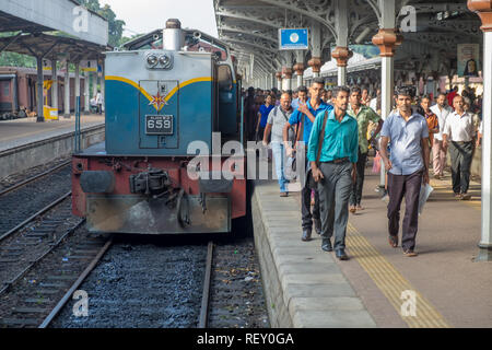 Kandy Train station, Sri Lanka, . Large group of commuters come out of train during morning rush hour - Stock Image
