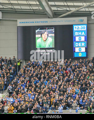 A ttribute and minutes applause for the great Gordon Banks before the FA Cup 5th round match between Brighton & Hove Albion and Derby County at the American Express Community Stadium . 16 February 2019 Photograph taken by Simon Dack  Editorial use only. No merchandising. For Football images FA and Premier League restrictions apply inc. no internet/mobile usage without FAPL license - for details contact Football Dataco - Stock Image