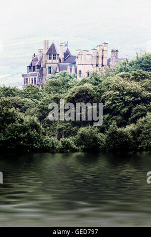 an old fairytale castle on the banks of a lake - Stock Image