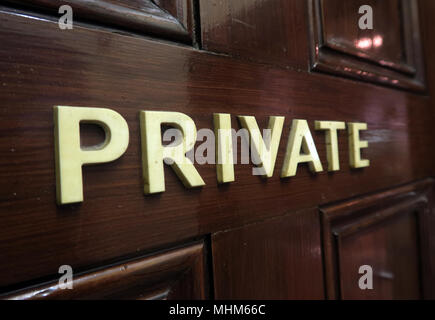 Private letters on a brown wooden door - Stock Image