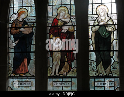 Patience Charity Humility Stained Glass in a church, South Window St Andrews Church Brympton D'Evercy Somerset England UK - Stock Image