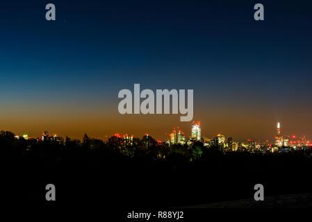 Dawn over the London skyline from Hampstead Heath, London, UK - Stock Image