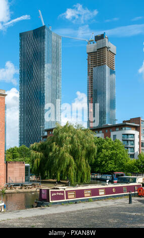 The Deansgate Square apartment blocks (under construction Aug 18).  From the Bridgewater Canal at Castlefield Basin, Manchester, England, UK. - Stock Image