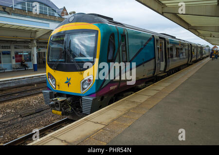 Trans Pennine Express train in Middlesbrough Station about to depart on a service to Manchester Airport - Stock Image