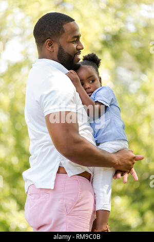 African American father parenting his daughter. - Stock Image