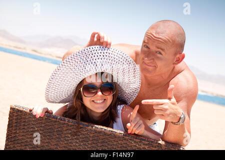 Happy couple enjoying themselves on the beach - Stock Image