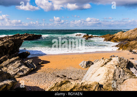 Waves and surf in a cove at Fistral Beach, Newquay, Cornwall, UK - Stock Image