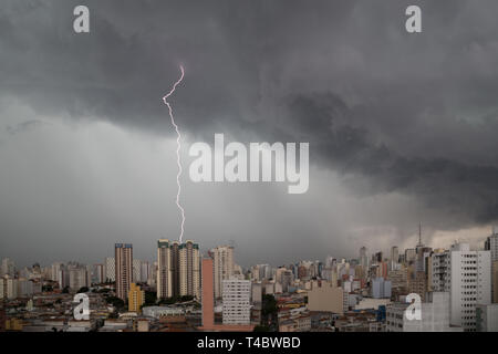Dark heavy clouds with lightning strike advanced towards downtown Sao Paulo, Brazil in the evening of December 22, 2015. - Stock Image