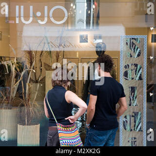 Shopping at an exclusive shop in Rimini, Emilia-Romagna, Italy - Stock Image