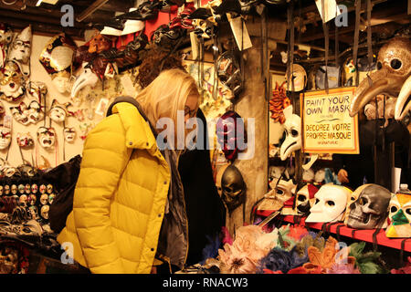 Venice, Italy. 16th Feb, 2019. Visitors select masks at a booth in Venice, Italy, Feb. 16, 2019. The masks on the Venice Carnival, scheduled from Feb. 16 until March 5, attracted lots of visitors. Credit: Huang Wanqing/Xinhua/Alamy Live News - Stock Image