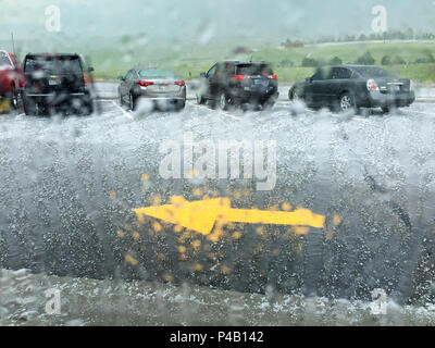 Hail and summer rain storm hits fast food parking lot, Miles City, Montana, United States - Stock Image