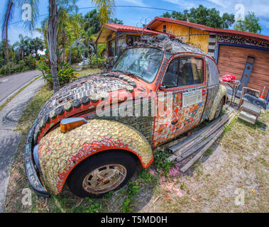 VW at Colorful psychedelic Whimzeyland or the Bowling Ball House in Safety Harbor Florida - Stock Image