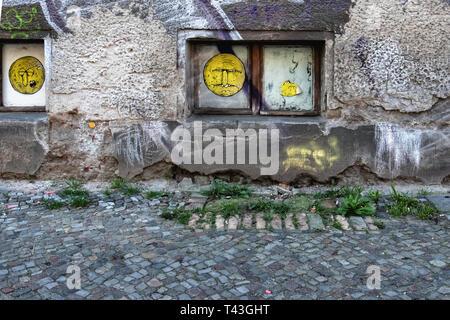 Berlin Mitte Schwedter strasse building detail. Basement window in dilapidated wall - Stock Image