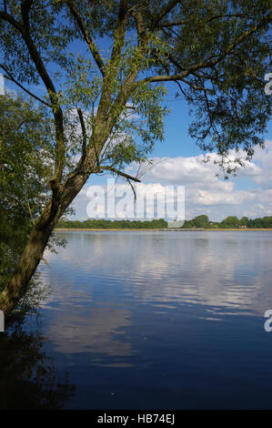 Looking over Engine Pool at Earlswood Lakes to the earth dam - Stock Image
