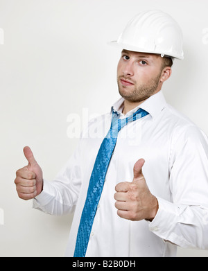 architect in good spirits with safety helmet - Stock Image