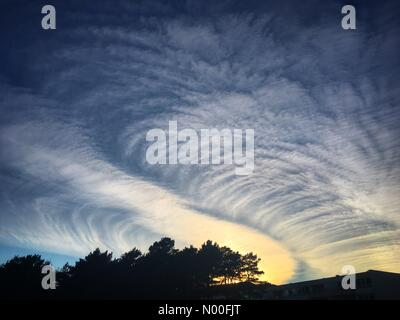 Bergen, Norway, NO. 4th July 2017. NO Weather. Strange cloud patterns created over a long time by na airliner at - Stock Image