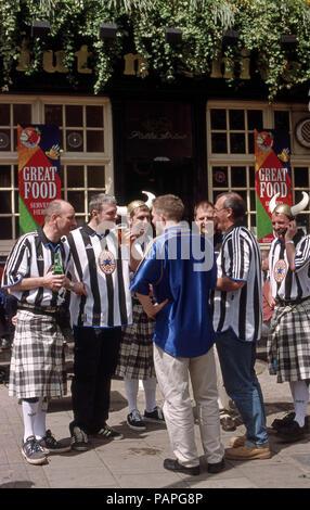 Newcastle football fans outside of a pub - Stock Image