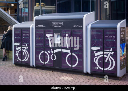 The Brompton Bike hire dock outside Reading Station, Berkshire. - Stock Image