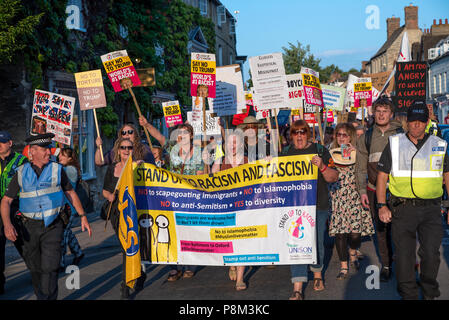 Woodstock, UK. 12th July, 2018. On the first day of US President Donald Trumps visit to the UK, a large Anti Trump protest took place outside Blenheim Palace, Oxfordshire. Within Blenheim Palace, the birth place of Churchill, Trump was having dinner. The protest was noisy but peaceful. Credit: Stephen Bell/Alamy Live News - Stock Image