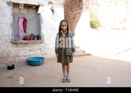 A young Bishnoi girl about to walk to her village school from her home. Near Jodhpur, Rajasthan, India. - Stock Image