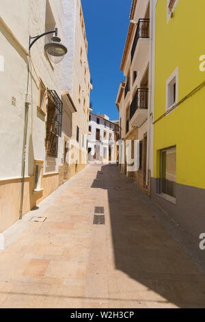 Narrow spanish street Xabia Spain - Stock Image