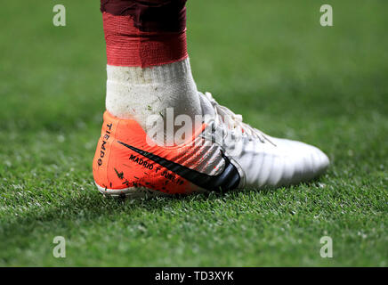 The special edition football boots worn by Liverpool's Jordan Henderson during the UEFA Champions League Final at the Wanda Metropolitano, Madrid. - Stock Image