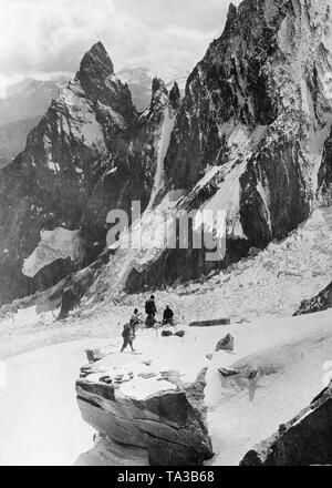 Climber in the Alps at the Franco-Italian border. - Stock Image