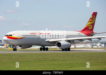 A Hainan Airlines of China Airbus A330, registration B-6539 preparing to take off from Manchester Airport, England. - Stock Image