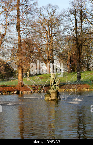 Fountain and Statue of Hercules Wrestling the Serpent River-god Achelous on the Lake at Kew Royal Botanical Gardens. - Stock Image