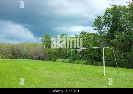 Soccer goal under a stormy sky. - Stock Image