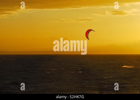 Sunset with paraglider - Stock Image