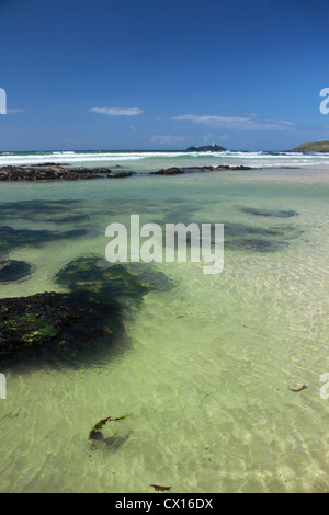 Clear green sea at Gwithian, West Cornwall - Stock Image