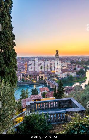 High angle view of Ponte Pietra (Stone Bridge) and Verona cathedral at sunset. Verona, Veneto, Italy - Stock Image