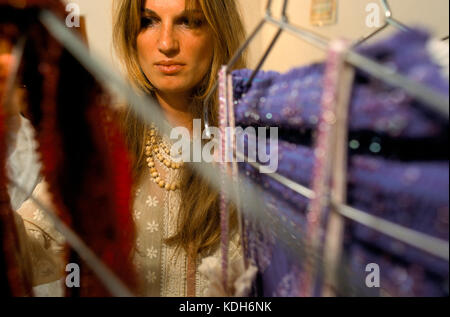 Jemima Khan checking colours at a dyeing workshop for her clothing line of dresses and saris that will be sold in - Stock Image