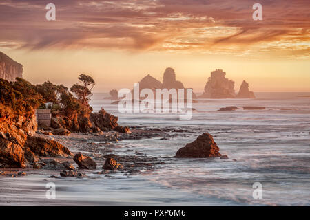 Sunset at one of New Zealand's most dramtic bits of scenery, Motukiekie, on the West Coast of the South Island. - Stock Image