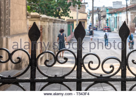 Everyday life in the Union Street framed in a colonial metalwork belonging to the Buenviaje Catholic Church - Stock Image