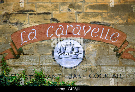 Arles; Bouches du Rhone, France; A restaurant sign painted on a wall - Stock Image