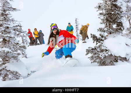 Girl snowboarder team group friends off-piste - Stock Image