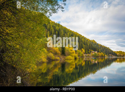 autumn landscape in Ultental ( Ultimo Valley) with a trees in autumn colors.the Lake Zoccolo ,Dolomites, South Tyrol, province of Bolzano, Italy, Euro - Stock Image