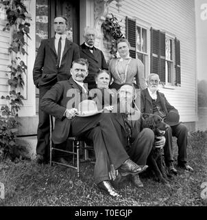 The family elders gather outside of the house for a group portrait, ca. 1915. - Stock Image