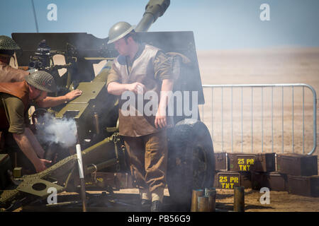 Anti-aircraft flak cannon being prepped and fired by British Military personnel taking part in the 2018 Southport Airshow - Stock Image