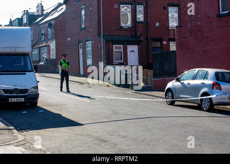 Leeds, UK - 26 February 2019.  Police are investigating murder scene in Harehills area of Leeds where a 21 year old woman is reported to have been killed. Credit: James Copeland/Alamy Live News - Stock Image