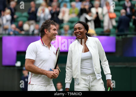 Venus Williams and Pat Cash at the end of the day on No.1 court at The All England Lawn Tennis Club, London. - Stock Image