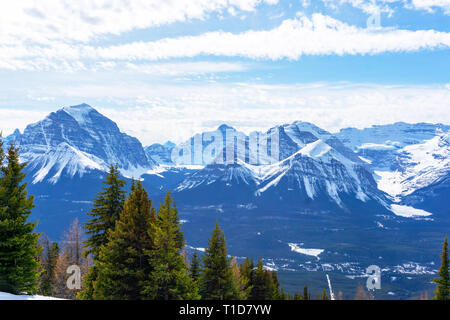 Snow-capped mountain landscape showing Mount Victoria glacier of the Canadian Rockies at Lake Louise near Banff National Park in Alberta, Canada. - Stock Image